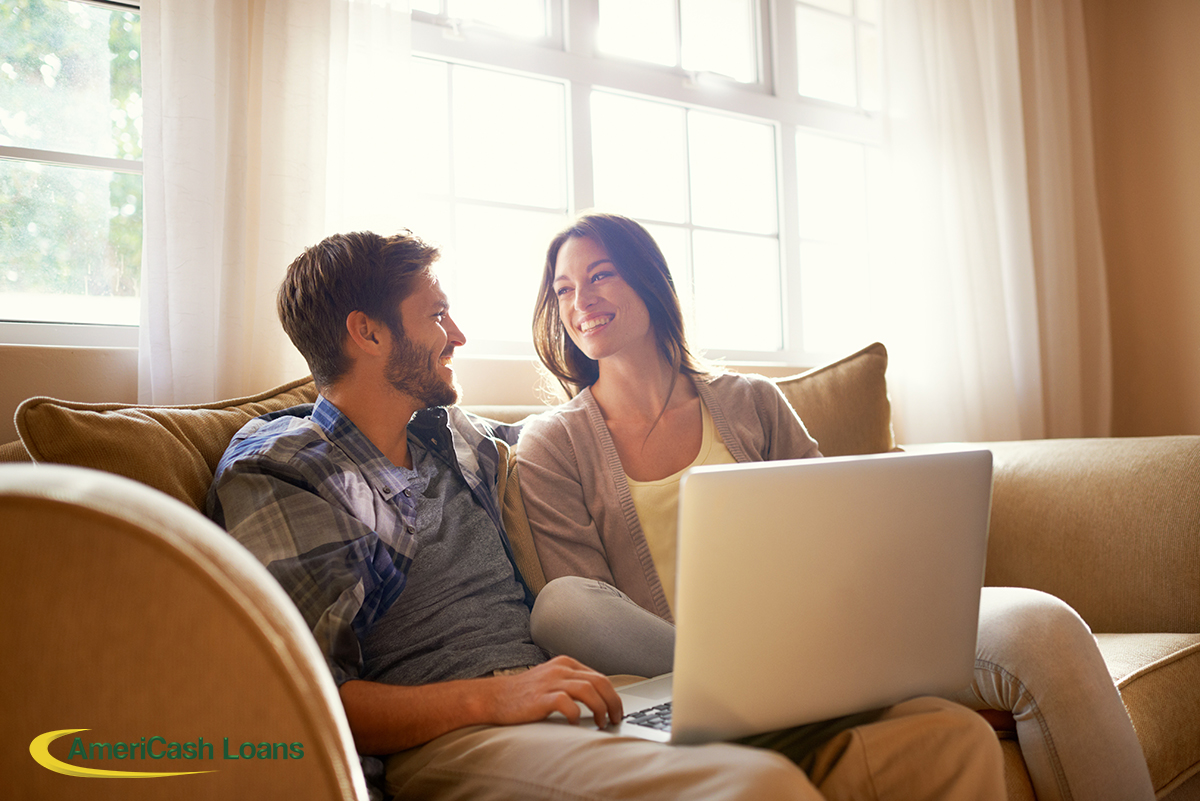 Couple Applying For A Loan Online