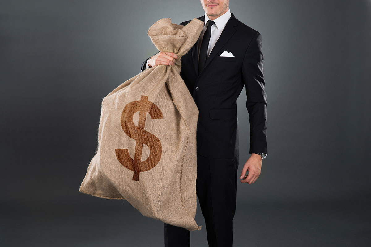 Man with large money bag